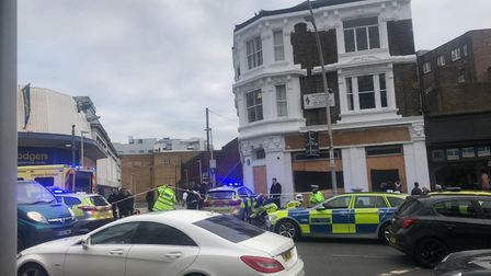 A cordon is in place outside the former Bodgers department store in Cranbrook Road, Ilford. Photo: R