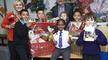 (Left to right) Samantha White from the youth centre, Dante, Savanna, Irfan Patel from M&S, Hannah,