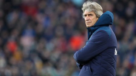 West Ham United manager Manuel Pellegrini appears dejected during the Premier League match at Turf M