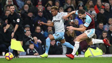 West Ham United's Grady Diangana (left) and Burnley's James Tarkowski battle for the ball during the
