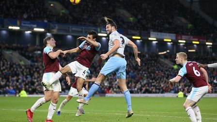 West Ham United's Andy Carroll (centre) heads towards goal during the Premier League match at Turf M