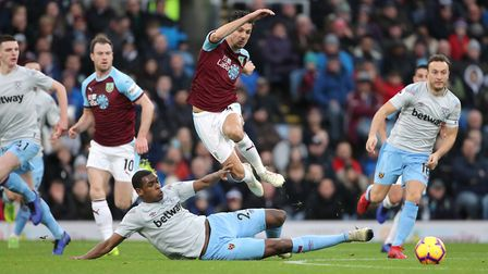 West Ham United's Issa Diop (bottom) and Burnley's Jack Cork battle for the ball during the Premier