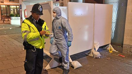 Police and forensic investigators at a property in Park Lane, London after a security guard was stab