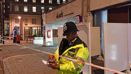 Police outside a property in Park Lane, London after a security guard was stabbed to death and three