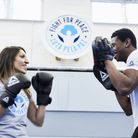 Shadow sports minister Rosena Allin-Khan learns the ropes at Fight For Peace. Picture: Lucy Pope
