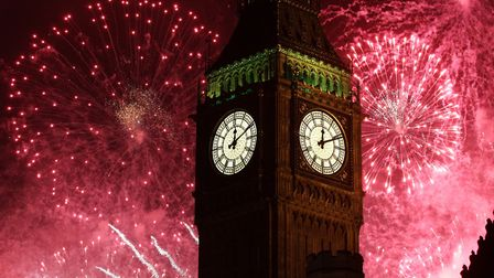 Embargoed to 0001 Friday December 30 File photo dated 01/01/13 of Fireworks lighting up Big Ben at m
