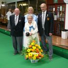 Bowler Joan Peters at 100 is presented with flowers by club President Dave Faust ,Ladies Captain Ann