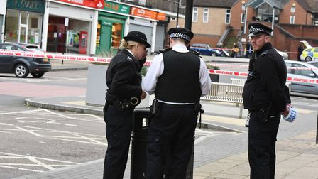 Police seal the road after a suspect package was found at Santander in Harold Hill.