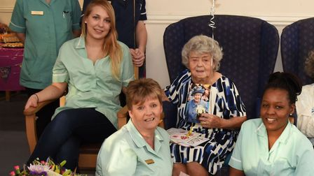 Cathy Pollard celebrating her 100th birthday with members of the care home staff