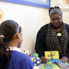 An officer from mental health charity Place2Be talking to students. Photo by Place2be