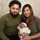 Ibrahim and Suniah Azam with baby Eesa. Picture: Ken Mears