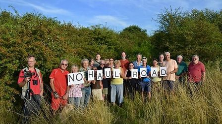 Wildlife campaigners protest plans for a haulage road for gravel transporting trucks set to run alon