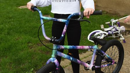 Maisy Hoey with her new bike which was bought from funding donated by strangers.
