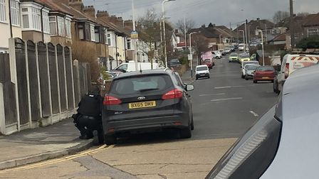 Armed police officers at the top of Hulse Avenue in Collier Row. Photo: @KelseyDowling