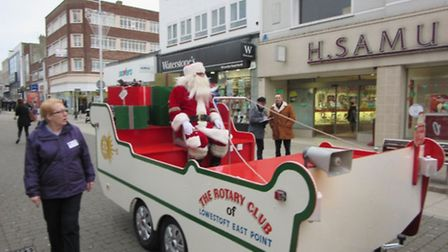 Santa arrives in Lowestoft for Santa's grotto at Palmers department store.