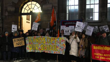 A crowd gathers in protest of the forced academisation of William Torbitt Primary School outside Red
