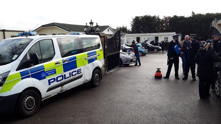 Police at the scene in Lower Bedford Road following the raids in the early hours of this morning. Ph