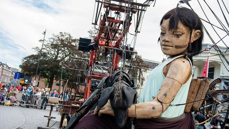 An animated marionette of French street theatre company Royal de Luxe parades through the streets in