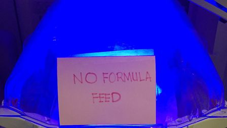 Karis White and her husband Andy resorted to this makeshift sign to prevent unwanted formula feeding