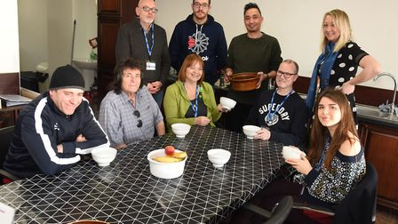 Rajiv KC and Charlotte Trower from Rajiv's Kitchen together with staff from Hope4Havering and client