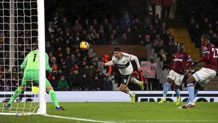 West Ham United defender Issa Diop (far right) watches on as Fulham's Aleksandar Mitrovic heads towa