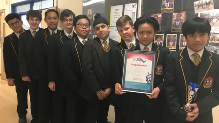 The winning St Bonaventure's pupils with their certificate. Picture: Di Halliwell