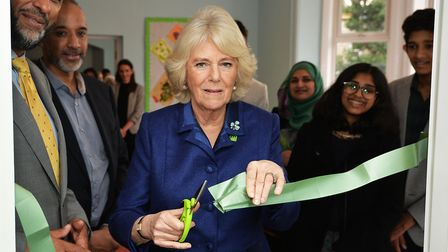 The Duchess of Cornwall, the patron of Barnardo's, cuts a ribbon to open a re-modelled play area of