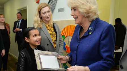 Camilla is given a drawing by a young girl during her visit. Photo: PA