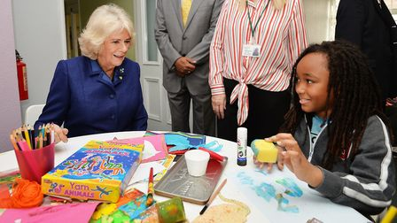 The Duchess chats to a young boy in an arts and crafts area. Photo: PA