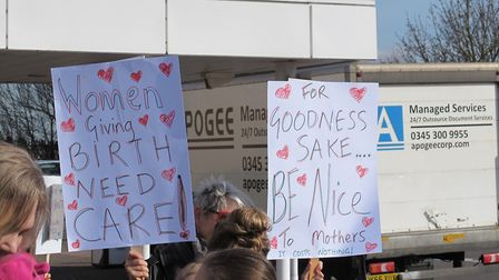 Demonstrators are opposing the use of screen to hide women in the NICU, a lack of communication arou