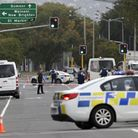 Police block the road near the shooting at a mosque in Linwood, Christchurch, New Zealand, Friday, M