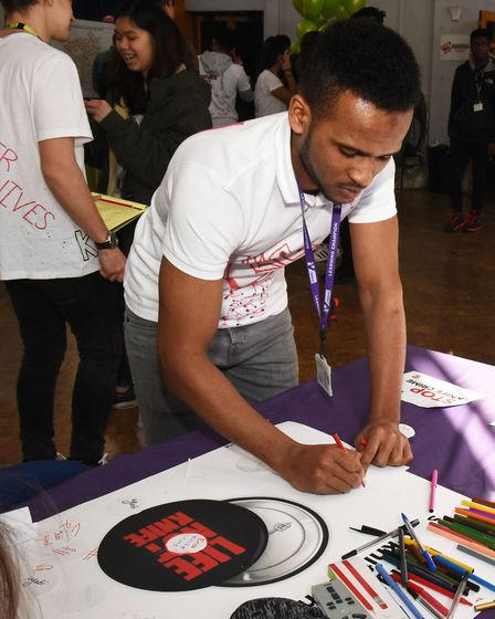 Students from the NewVic taking part in the Lfe Not Knife event at the college.