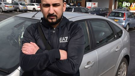Asif Hussain with his parking fine at the Aldi store car park in Seven Kings.