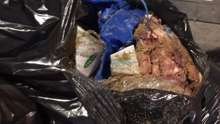 Bin bags full of raw meat dumped near the family butchers. Picture: Newham Council