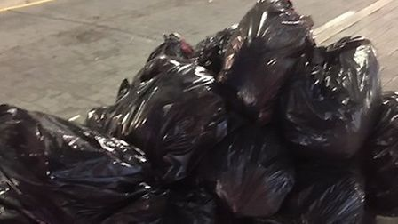 Raw meat concealed inside 30 black bin bags dumped on High Street North, East Ham. Picture: Newham C