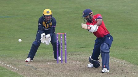 Varun Chopra hits out for Essex as Chris Cooke looks on from behind the stumps during Glamorgan vs E