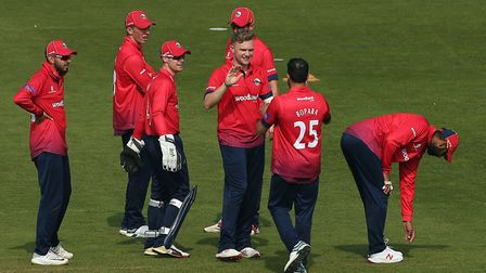 Sam Cook of Essex celebrates with his team mates after taking the wicket of Craig Meschede during Gl