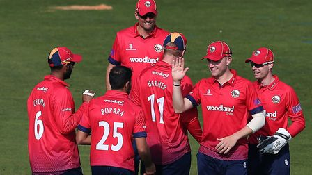 Ravi Bopara of Essex celebrates with his team mates after taking the wicket of Kiran Carlson during