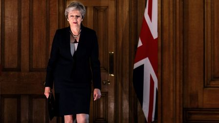 Britain's Prime Minister Theresa May arrives to make a statement on the Brexit negotiations following a European Union...