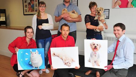 Pets on Parade competition winners collect prizes from Picture Studios, Lowestoft.
