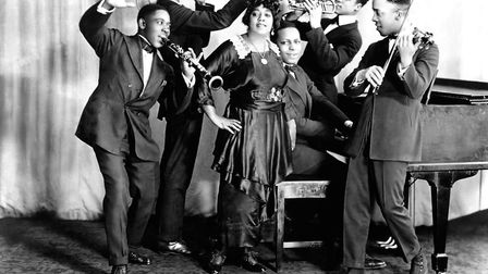 Mamie Smith and her Jazz Hounds (including Willie 'The Lion' Smith on piano) pose for a portrait cir