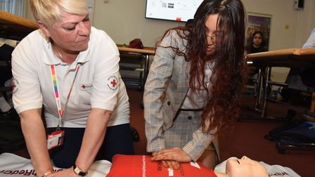 Suzanne Palka from the British Red Cross teaching lifesaving first aid skills to Amelia Crorie in th
