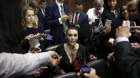 Actress Alyssa Milano talks to the media after she arrived for the Senate Judiciary hearing with Chr