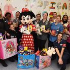 Highway Express staff Kerrie Wilkinson and Sarah Barker presenting Easter eggs to the children's war