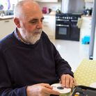 A resident using a Daisy. Picture: RNIB