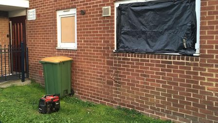 The window of a ground floor flat has been covered up. Picture: Jon King