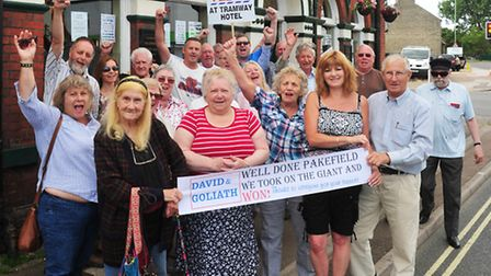 Campaigners celebrate the news that Tesco's will not be turning the Tramway pub into a shop.