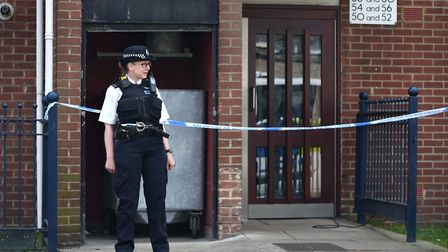 Police outside a block of flats in Vandome Close, Custom House. Picture: Dominic Lipinski/PA Wire