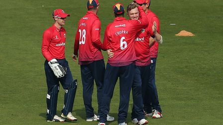 Sam Cook of Essex celebrates with Varun Chopra after taking the wicket of Craig Meschede during Glam