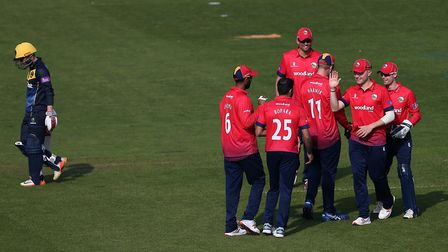 Ravi Bopara of Essex celebrates with his team-mates after taking the wicket of Glamorgan's Kiran Car